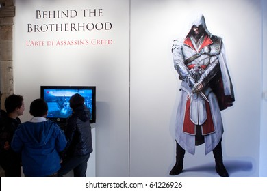 """LUCCA, ITALY - OCTOBER 30: paintings exposition """"Assassins Creed - Behind the Brotherhood"""" at Lucca Comics and Games 2010 fair on October 30, 2010 in Lucca, Italy."""