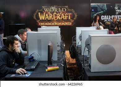 LUCCA, ITALY - OCTOBER 30: visitors play World of Warcraft videogame at Lucca Comic sand Games 2010 fair on October 30, 2010 in Lucca, Italy.