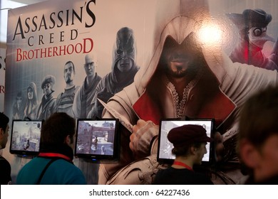 LUCCA, ITALY - OCTOBER 30: vistors play Assassins Creed Brotherhood videogames at Lucca Comic sand Games 2010 fair on October 30, 2010 in Lucca, Italy.