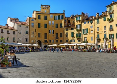 Lucca, Italy - September 25, 2018: Amphitheater Square or Piazza dell'Anfiteatro in center of city