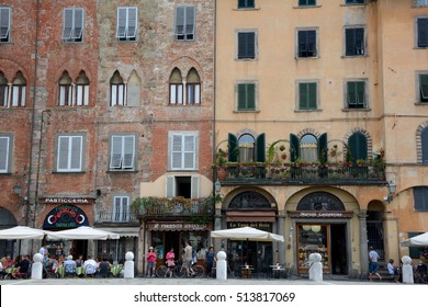 Lucca, Italy - September 5, 2016: Buildings on Piazza San Michele square in old part of Lucca city in Italy. Unidentified people visible.