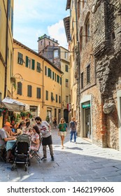 LUCCA, ITALY - SEPYEMBER 16, 2018: Amphitheater Street (via della Anfiteatro) bends around the structure of the former Roman amphitheater, rebuilt into residential buildings today.