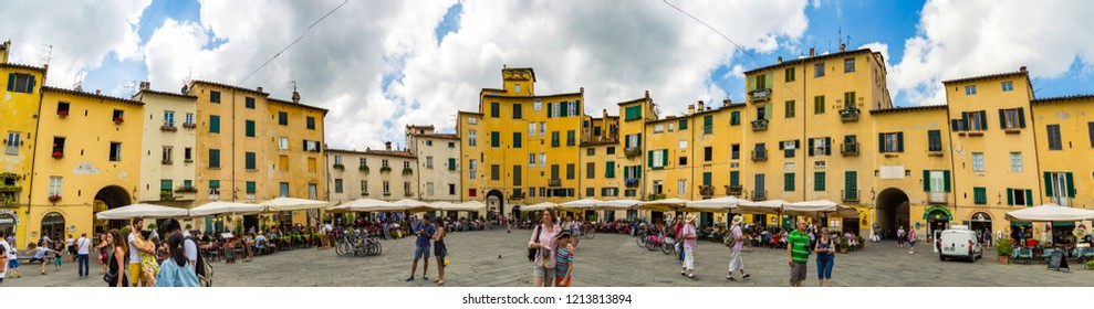 Lucca, Tuscany / Italy - June 04th 2017: Peoples walking in a rounded square of Lucca city, panoramic view