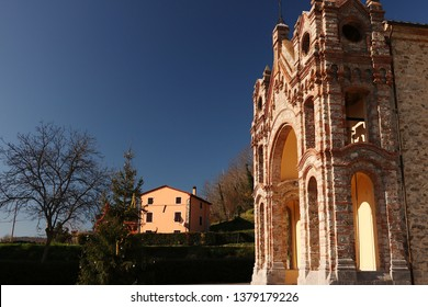 Lucca, Tuscany, Italy. Neo-Gothic church in the Lucca countryside. A village in the Lucca countryside is home to a small church built with stone and brick.