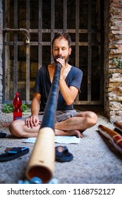 Lucca,Italy - 2 August 2018:Man plays Didgeridoo during a festival in Lucca.
