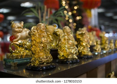 Lucena City, Philippines - January 6, 2019: Golden Buddha lucky charm for the year of the pig, Lucena City, Philippines