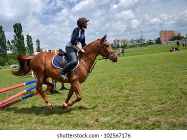 LUCENEC, SLOVAKIA MAY 13, Unidentified rider participates on the Horse Day Show jumping May 13, 2012 in Lucenec, Slovakia