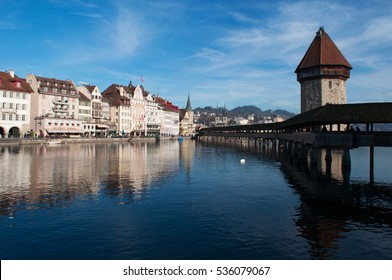 Lucerne, 08/12/2016: the skyline of the medieval city with view of the famous Water Tower and the Chapel Bridge, the covered wooden footbridge built in 1333 and spanning across the Reuss River