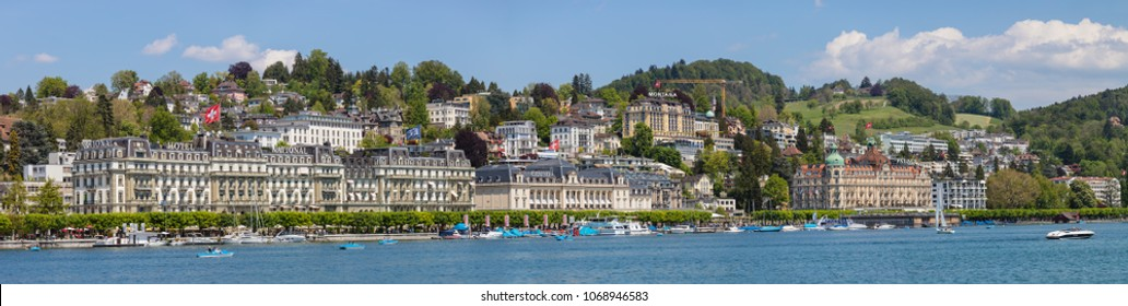 Lucerne, Switzerland - 8 May, 2016: buildings of the city along Lake Lucerne. Lucerne is a city in central Switzerland, it is the capital of the Swiss canton of Lucerne.