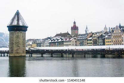 Lucerne switzerland. Cityscape view of Chapel bridge and historic city center of Lucerne with famous lake Lucerne (Vierwaldstattersee) in beautiful winter day with snow, Canton of Luzern, Switzerland