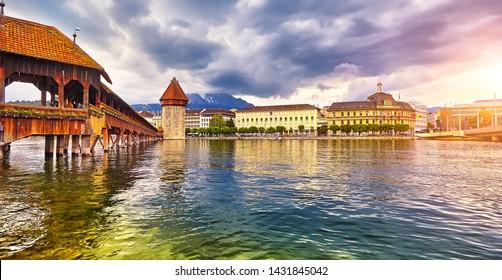 The Lucerne, Switzerland - Famous wooden Chapel Bridge, oldest wooden covered bridge in Europe. Luzern