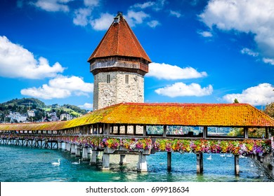 Lucerne, Switzerland - Famous wooden Chapel Bridge, oldest wooden covered bridge in Europe. Luzern, Lucerna in Swiss country.