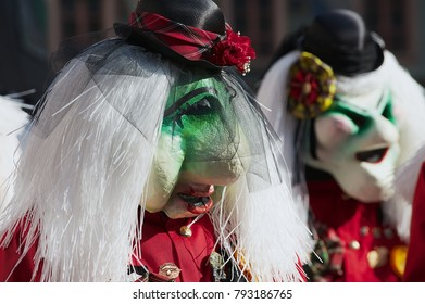 LUCERNE, SWITZERLAND - FEBRUARY 20, 2012: Unidentified people wearing masks take part in the parade during carnival in Lucerne, Switzerland.