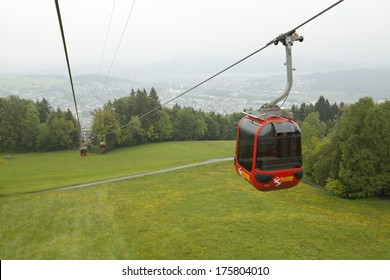 Lucerne, Switzerland - June 2, 2013: Red cable car railway at Pilatus Mountain and landscape view at Lucern Switzerland
