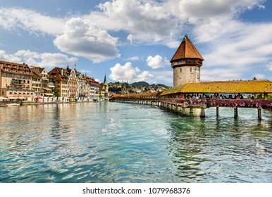 Lucerne, Switzerland - June 23, 2012: Famous wooden Chapel Bridge in the historic city center of Lucerne.