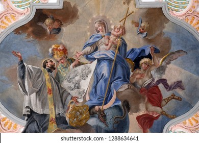 LUCERNE, SWITZERLAND - JUNE 24, 2018: St. Francis before the Mother of God, fresco on the ceiling of the Jesuit church of St. Francis Xavier in Lucerne, Switzerland