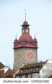 LUCERNE, SWITZERLAND - JUNE 24, 2018: Historical clock tower in old town city Lucerne, Switzerland