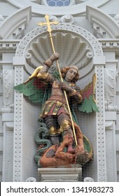 LUCERNE, SWITZERLAND - JUNE 24, 2018: Saint Michael slaying the dragon, statue on the portal of the church of St. Leodegar in Lucerne, Switzerland