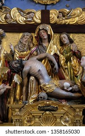 LUCERNE, SWITZERLAND - JUNE 24, 2018: Mary with the body of Christ on her knees statue on the Soul Altar altar in the church of St. Leodegar in Lucerne, Switzerland