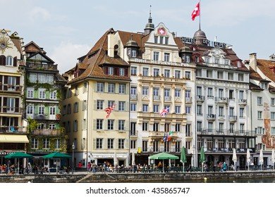 LUCERNE, SWITZERLAND - MAY 02, 2016: Hotels along the river Reuss shows the unique character of the city and variety of sightseeing attractions. The town is a destination for many travelers