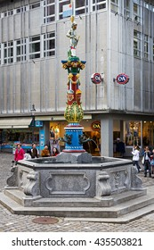 LUCERNE, SWITZERLAND - MAY 04, 2016: Fritschi Fountain in Gothic style with its colorful pillar is located in old town. A variety of fountains is a great tourist attraction in the city