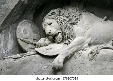 Lucerne, Switzerland - May 05, 2009: View to the Dying Lion monument. Carved in the rock to honor the Swiss Guards of Louis XIV of France.