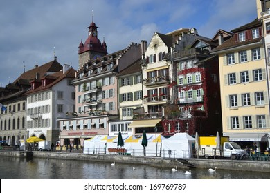 LUCERNE, SWITZERLAND - NOVEMBER 5, 2013: View of embankment in center of Lucerne. City in the heart of the Swiss plateau, the capital of the eponymous German-speaking canton of Lucerne.