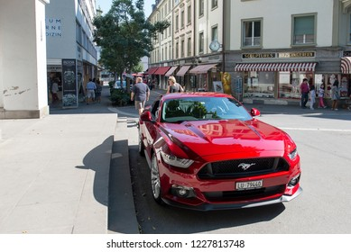 Lucerne/Switzerland - August 21 2015: A red Ford Mustang at Denkmalstrasse street Lucern, Switzerland. Lucerne is the capital of the Canton of Lucerne and the capital of the district of the same name.