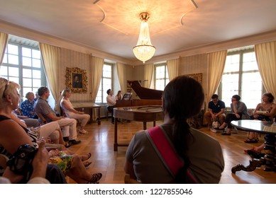 Lucerne/Switzerland - August 29 2015: People listening to music at Richard Wagner museum. The house is in the Tribschen district of Lucerne, Switzerland, where Richard Wagner lived from 1866 to 1872.