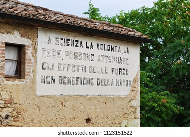 Lucignano d'Asso, Montalcino, Siena, Tuscany / Italy - September 11 2009: Words of Mussolini on the wall of a building.
