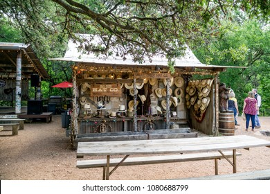 LUCKENBACH, TEXAS - APRIL 29th, 2018: Hat Company selling hats next to the outdoor music venue in Luckenbach Texas. Made famous by the song Luckenbach Texas by Waylon Jennings and Willie Nelson