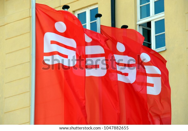 Luckenwalde, Brandenburg / Germany - May 09, 2016: Flags with the Logo of the german Savings Bank - Sparkasse - in front of a branch in Luckenwalde, Germany