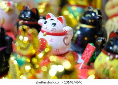 Lucky cat for fortune on golden blurring background