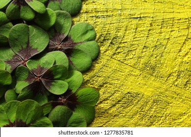 lucky clover border on black yellow wooden background