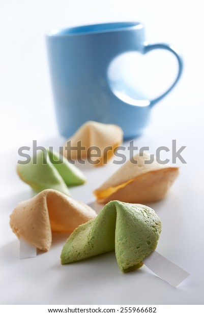 Lucky cookies with love shape cup in mood lighting