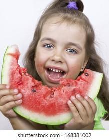 Lucky girl eating watermelon