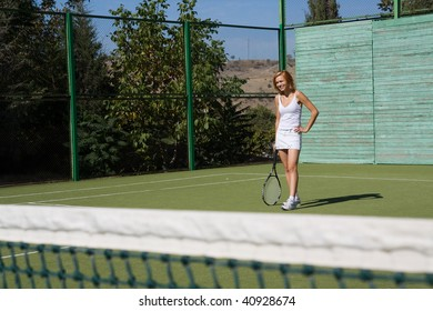 Lucky girl and a friend played tennis on the court