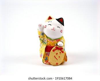 Lucky japanese cat souvenir ,maneki neko happy cat isolated on white background