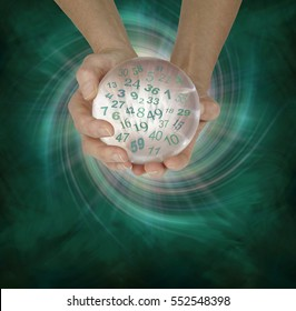 Lucky Lottery Numbers 1 to 59 - female hands cupped around a large crystal ball with random lottery numbers emerging  on a  green black spiraling energy field background with copy space below