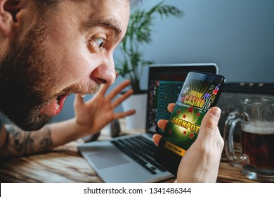 Lucky man celebrating victory after winning jackpot in online casino.