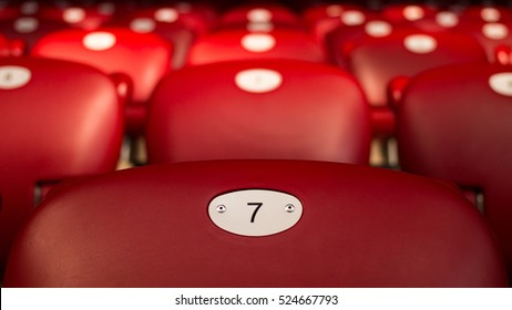 Lucky Number Seven On Empty Red Chair