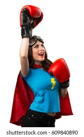 Lucky pretty superhero girl  with boxing gloves
