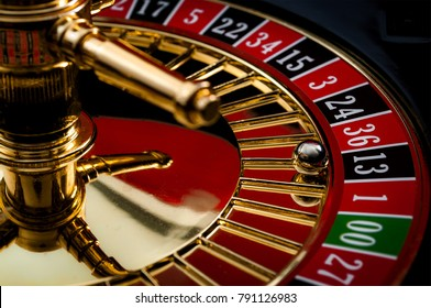 Lucky thirteen and casino gambling concept with a closeup on a section of the of roulette wheel with the ball in the winning number 13 black