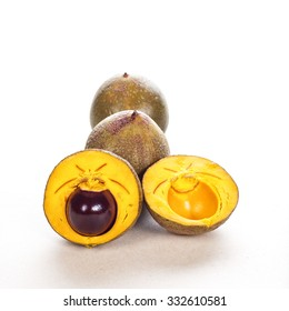 lucuma fruit against a white background