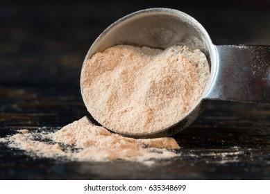 Lucuma Powder Spilled from a Teaspoon