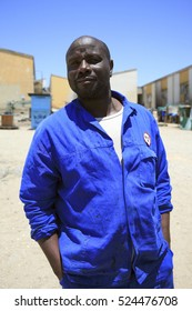LUDERITZ, NAMIBIA, DEC 25: Outdoor portrait of handsome black African mid age man with blue workwear in the shantytown of Luderitz. Nambia 2006