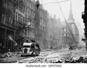 Ludgate Hill area of London with firemen, equipment, and burnt out buildings during the 'Blitz'. Between September 1940 and May 1941, Nazi Germany bombed British cities.