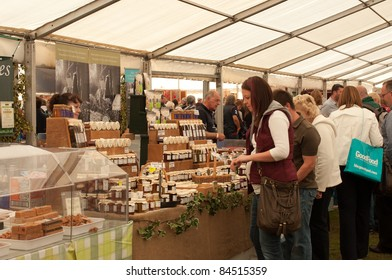 LUDLOW, UK-SEPTEMBER 11: Ludlow Food Festival, customers shopping in the main marquee of the food festival in the grounds of Ludlow castle on September 11, 2011