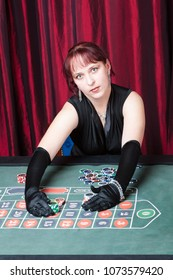 ludomania, lass wearing  black gloves and black dress parlays in a casino