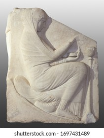 Ludovisi Throne. Ancient sculpted block of white marble with bas-reliefs. Right panel: crouching veiled woman offering incense